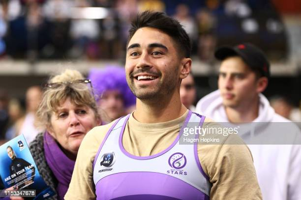 Rugby league player Shaun Johnson looks on during the ANZ Premiership Netball Final between the Pulse and the Stars at Te Rauparaha Arena on June 03...