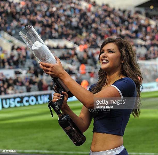 Rugby League Rockette dancer shoots a tshirt into the crowd during the half time interval of the Barclays Premier League match between Newcastle...