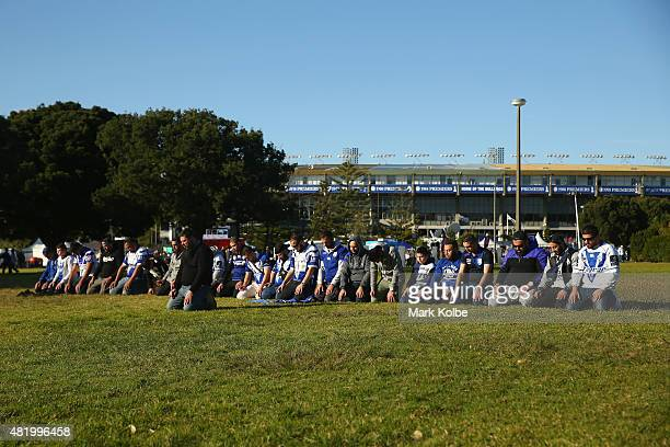 Rugby league supporters stop to pray outside the ground as they crowd arrives for the round 20 NRL match between the Canterbury Bulldogs and the...