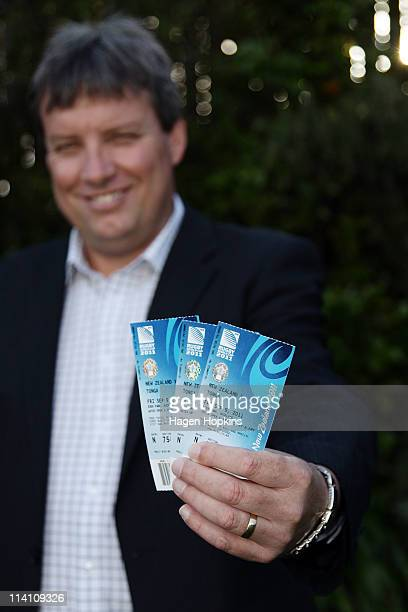 MAY 12 Rugby NZ 2011 CEO Martin Snedden poses with the first Rugby World Cup tickets to be printed during the Rugby World Cup 2011 ticket launch on...