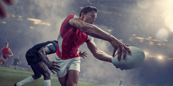 Rugby Player About To Pass Ball Just Before Being Tackled 994291574