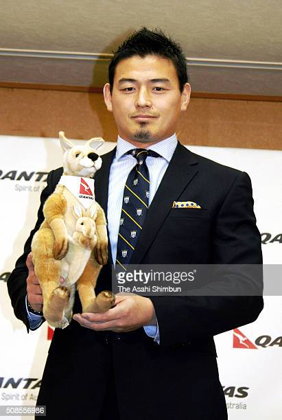 Rugby player Ayumu Goromaru poes for photographs prior to his departure to Australia at the Narita International Airport on February 5 2016 in Narita...