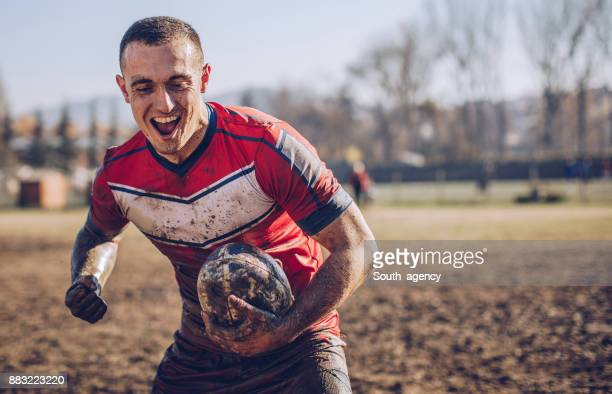 Rugby player celebrating after winning