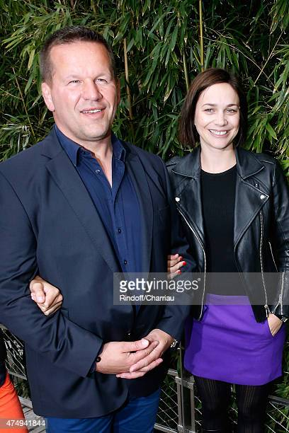 Rugby Player Christian Califano and Skater Nathalie Pechalat attend the 2015 Roland Garros French Tennis Open Day Five on May 28 2015 in Paris France