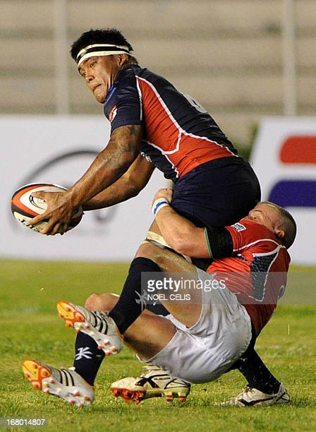 Rugby player Christopher Hitch of Philippines is tackled by Hong Kong rugby player Peter Mckee during their Rugby Asian FiveNations match at the...