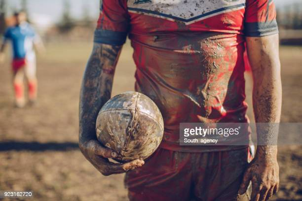 rugby player covered in mud - sports uniform stock pictures, royalty-free photos & images