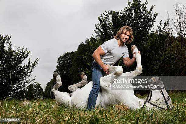 Rugby player Dimitri Szarzewski is photographed for Paris Match with Nador a horse trained by Mario Luraschio June 11 2015 in BourglaReine France