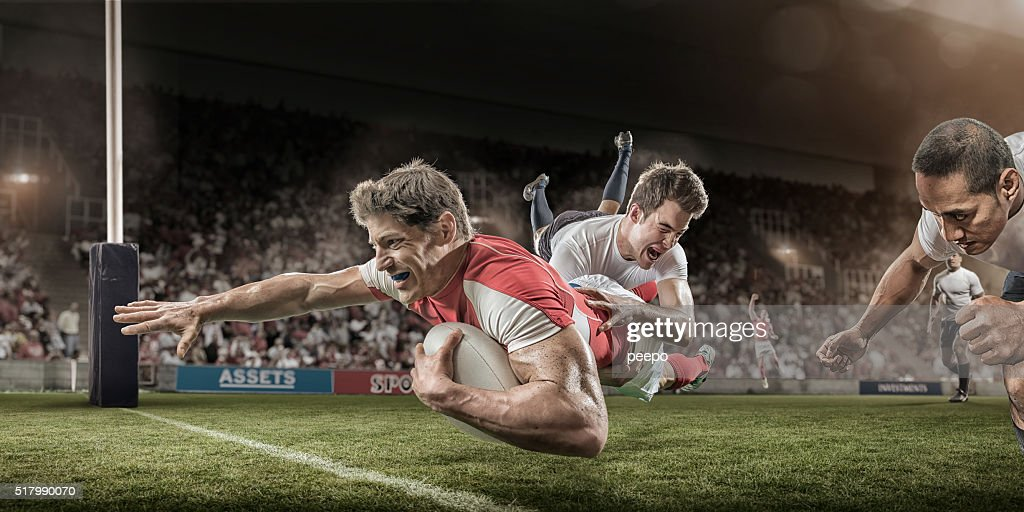 Rugby Player Dives to Score Whilst Being Tackled : Stock Photo