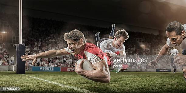rugby player dives to score whilst being tackled - rugby stock pictures, royalty-free photos & images
