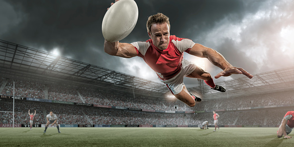 Rugby Player Diving in Mid Air About To Score 498889746