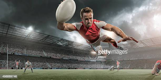 rugby player-diving in der luft um zu punkten - rugby stock-fotos und bilder