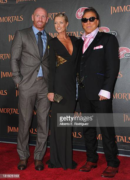 Rugby player Gareth Thomas Anasstasija Makarenko and actor Mickey Rourke arrive at Relativity Media's 'Immortals' premiere presented in RealD 3 at...