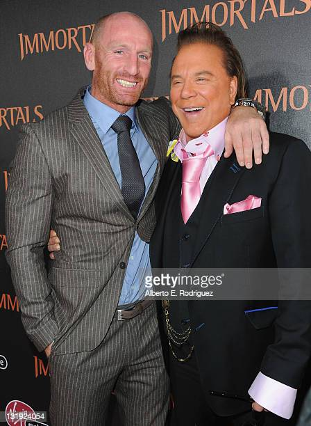 Rugby player Gareth Thomas and actor Mickey Rourke arrive at Relativity Media's 'Immortals' premiere presented in RealD 3 at Nokia Theatre LA Live at...