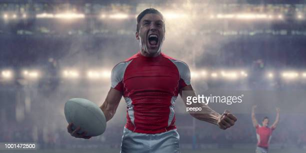 rugby player holding ball and shouting in victory celebration - rugby stock pictures, royalty-free photos & images
