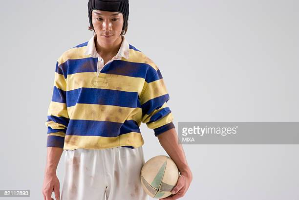 Rugby player holding ball