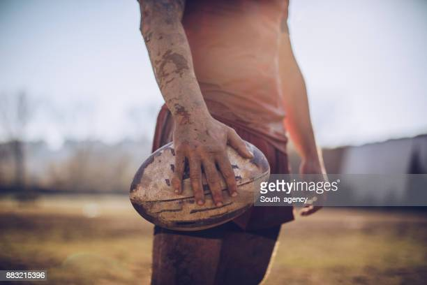 rugby player holding ball - rugby stock pictures, royalty-free photos & images