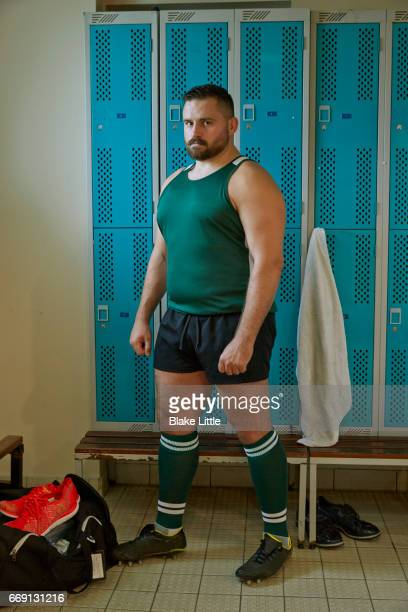 rugby player in locker room, london - rugby players in changing room stock photos and pictures
