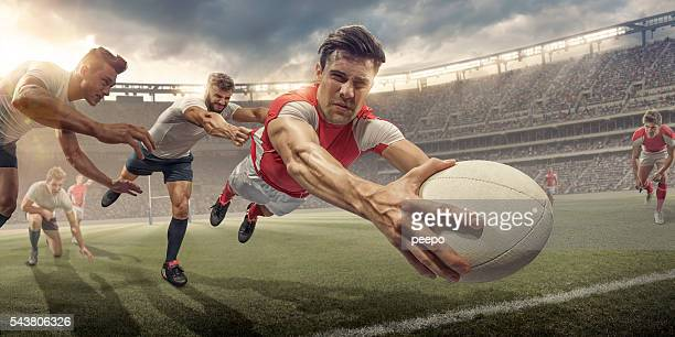 Rugby Player In Mid Air Dive About To Score