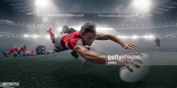 rugby player in mid air dive with ball to score - sports league stock pictures, royalty-free photos & images