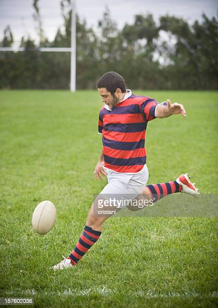rugby player kicking a ball - kicking stock pictures, royalty-free photos & images