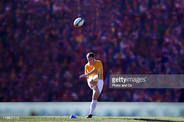 rugby player kicking ball - kicking stock pictures, royalty-free photos & images