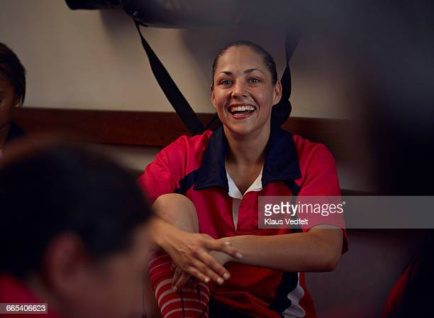 rugby player laughing in changing room - frauen rugby stock-fotos und bilder