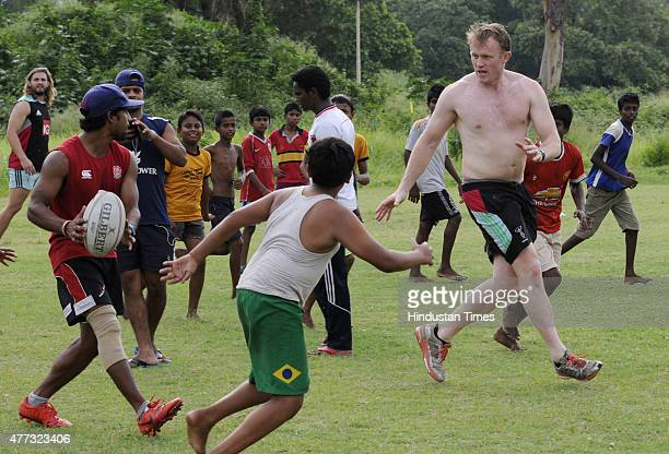 Rugby player of English Rugby club Harlequin Football Club Chrish Robshaw playing with under privileged children of an NGO to promote the game at...