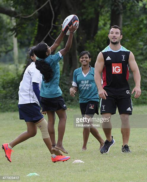Rugby player of English Rugby club Harlequin Football Club George Lowe playing with under privileged children of an NGO to promote the game at...