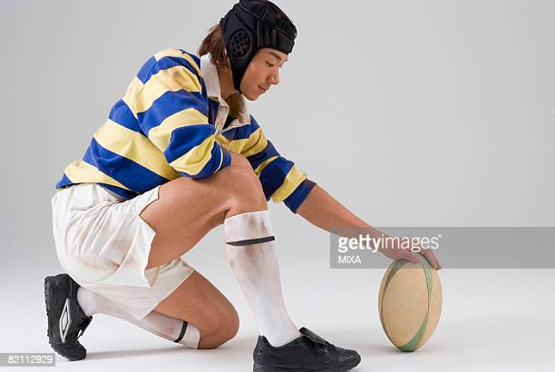 Rugby player placing ball