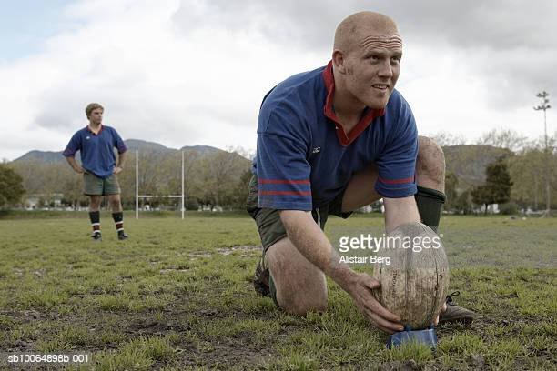 rugby player positioning ball on rugby pitch - rugby team stock pictures, royalty-free photos & images