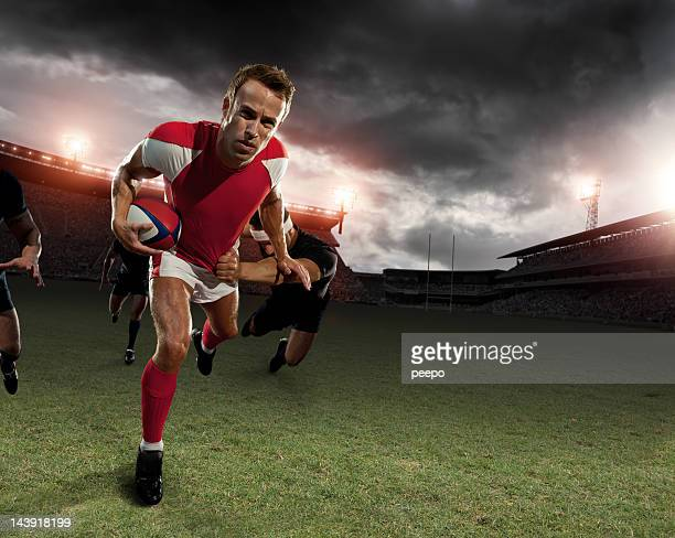 rugby player running with ball - rugby stock pictures, royalty-free photos & images