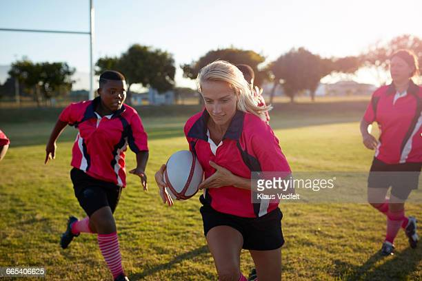 rugby player running with ball - rugby stock-fotos und bilder
