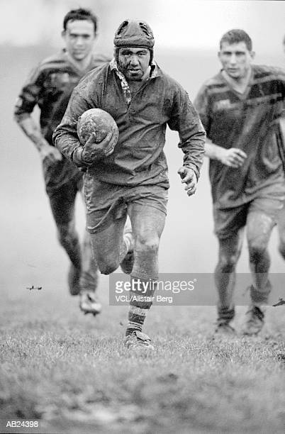 Rugby player running with ball (B&W)