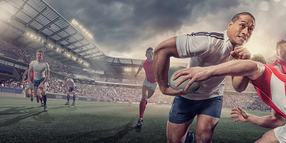 Rugby Player Running With Ball Whilst Being Tackled During Match 545104502