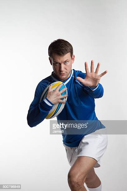 Rugby player running with rugby ball