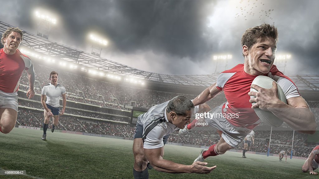 Rugby Player Scores in Heroic Dive During Rugby Game : Stock Photo