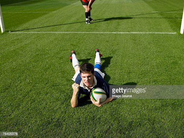 rugby player scoring a try - try scoring stock pictures, royalty-free photos & images