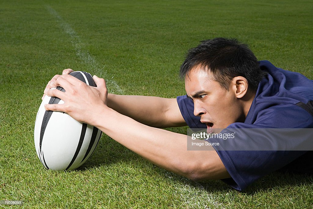 A rugby player scoring a try : Stock Photo