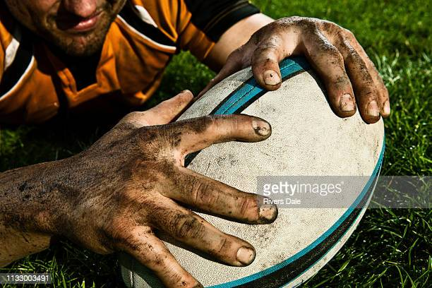 Rugby player scoring on pitch
