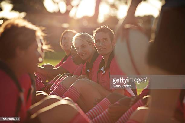 Rugby player smiling at practice in the field