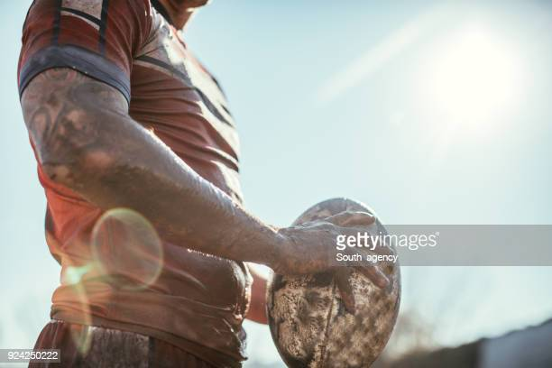 rugby player standing on a playing field with ball - rugby stock pictures, royalty-free photos & images