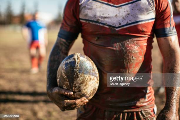 rugby player standing on a playing field with ball - rugby ball stock pictures, royalty-free photos & images
