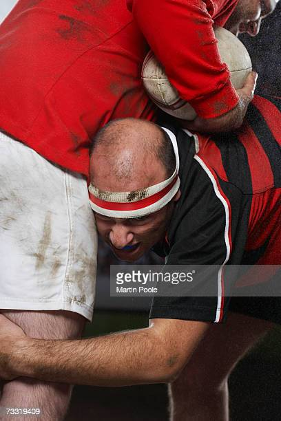Rugby player tacking opponent, mid section