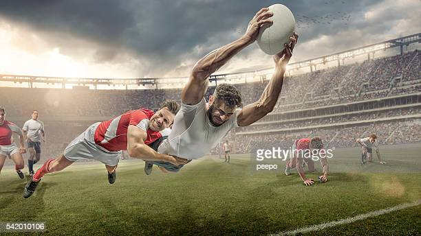 rugby player tackled in mid air dives to score - rugby stock pictures, royalty-free photos & images