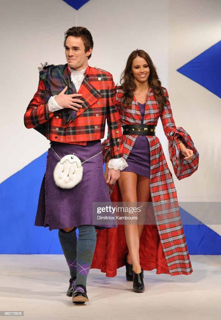 Rugby Player Thom Evans (L) walks the runway at the 8th annual 'Dressed To Kilt' Charity Fashion Show at M2 Ultra Lounge on April 5, 2010 in New York City.