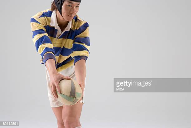 Rugby player trying to throw ball