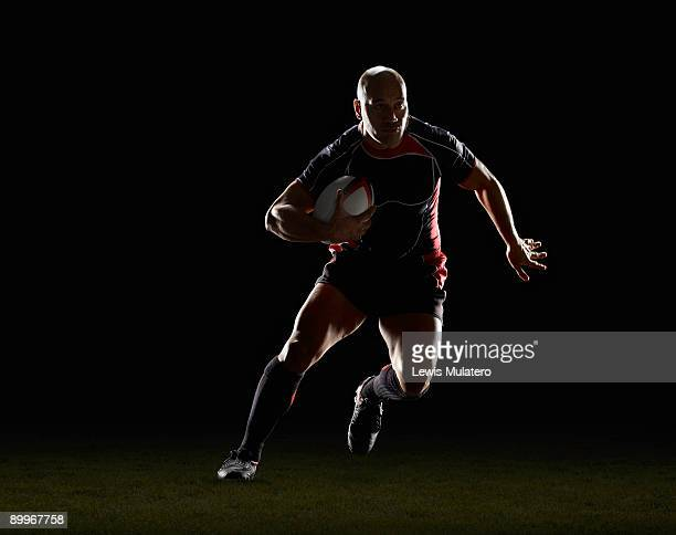 rugby player with ball side stepping - rugby stock pictures, royalty-free photos & images