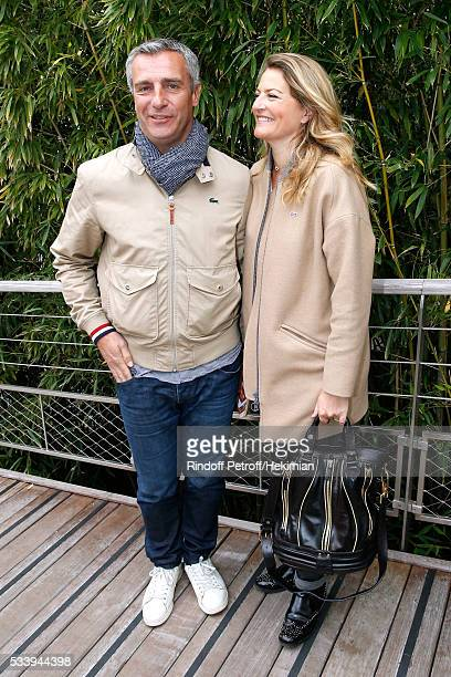 Rugby player Yann Delaigue and journalist Astrid Bard attend the 2016 French Tennis Open Day Three at Roland Garros on May 24 2016 in Paris France