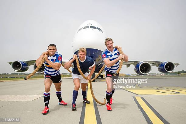 Rugby players Bryan Habana of South Africa Chris Robshaw of England and Jean de Villiers of South Africa try to tow the new British Airways A380...