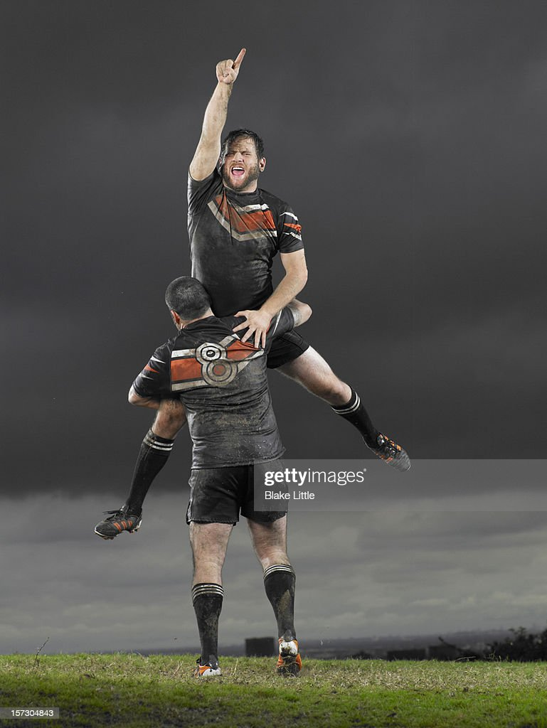 Rugby players celebrating. : Stock Photo